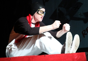 Snoopy (Will Oliver) fights the Red Baron in Theatre Bristol's production of You're A Good Man, Charlie Brown
