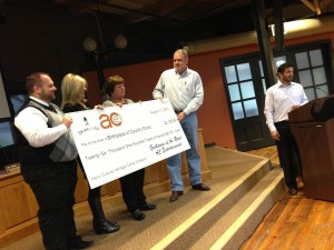 AC Entertainment presents check for $26,125.89!
