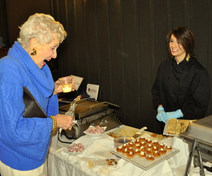 Ruth King enjoys a bite from Shindigs at 2013's Downtown Showcase.