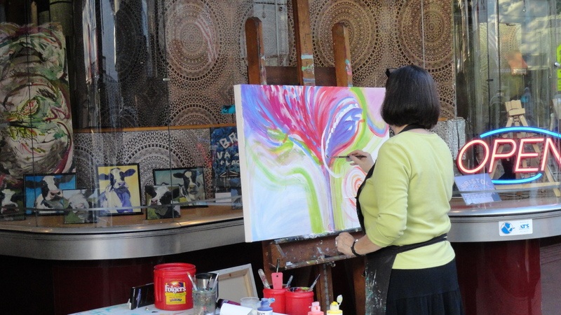 Pat Jessee paints an inspired piece outside blowfish emporium during Art D'Vine